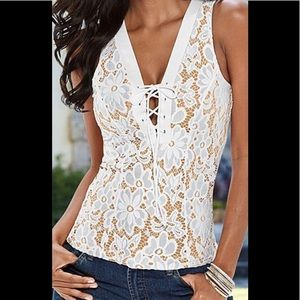 White and beige sleeveless lace top.